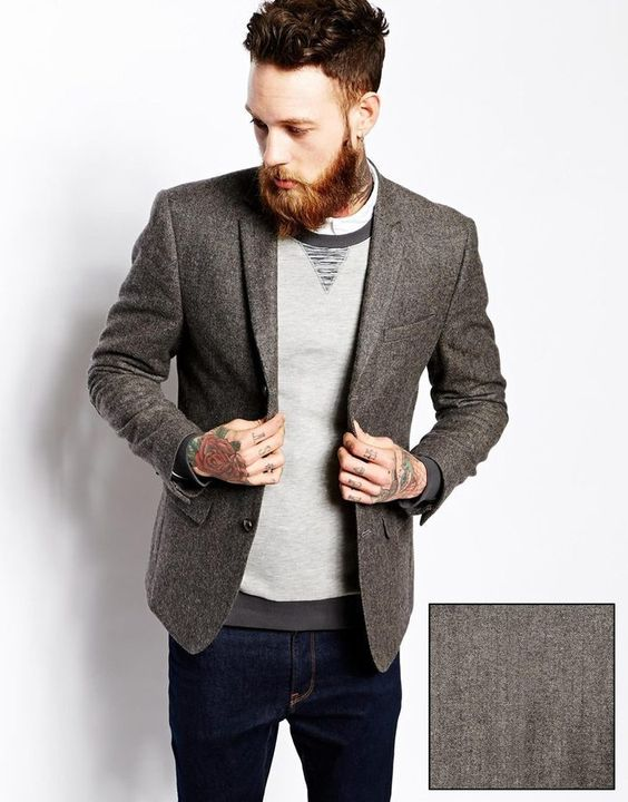 Picture Of navy denim, a light grey jumper and a tweed jacket