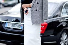 24 white midi skirt, a black top, heels and a tweed jacket