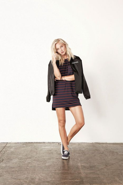 striped skater dress, a bomber jacket and black Vans