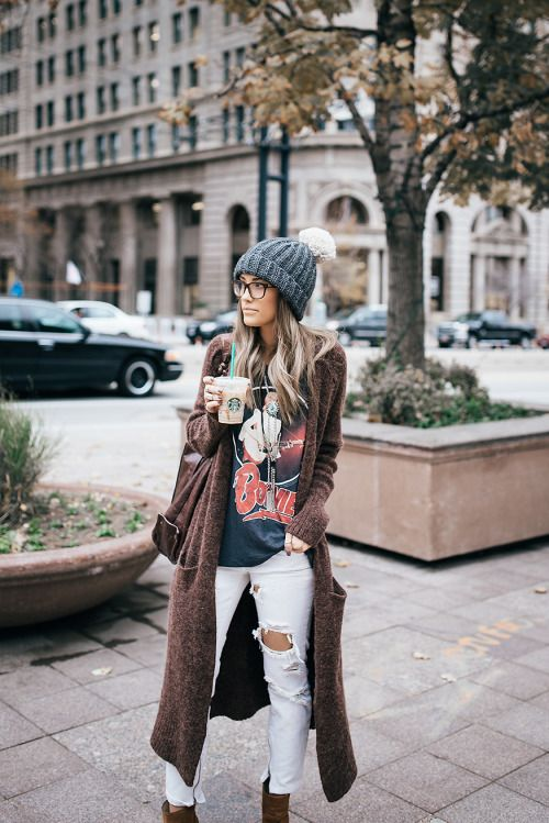 ripped white jeans, a printed tee, a long brown cardigan and ankle boots