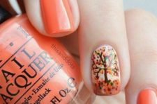 27 orange nails with a tree accent