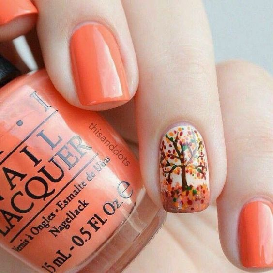orange nails with a tree accent