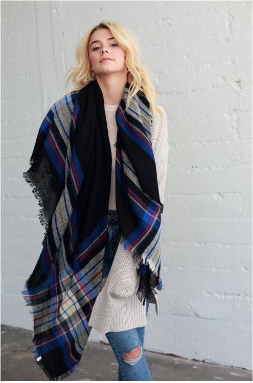 ripped denim, an oversized nude sweater and a two layer blanket scarf