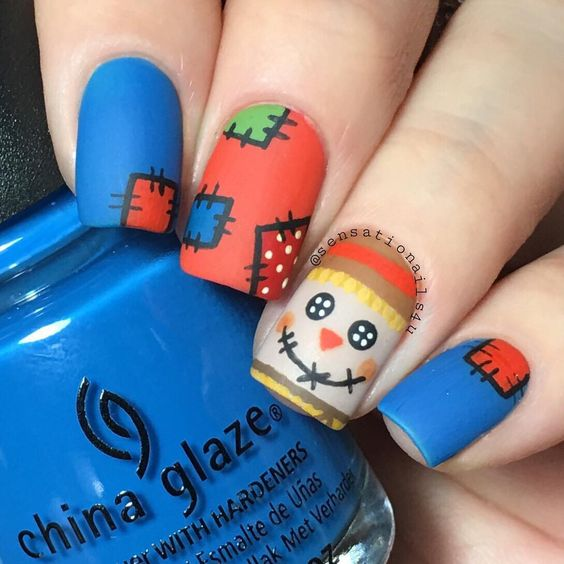 scarecrow matte nails for Thanksgiving and fall - 29 Cozy And Eye-Catchy Thanksgiving Nails Ideas - Styleoholic