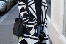 Black and white look with black turtleneck, jeans and high boots