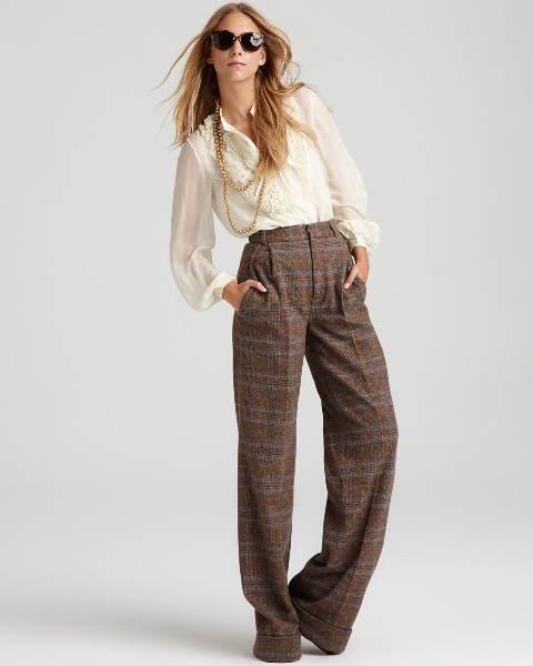 High-waisted trousers with creme blouse