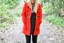 Red coat with black dress, black tights and purple boots