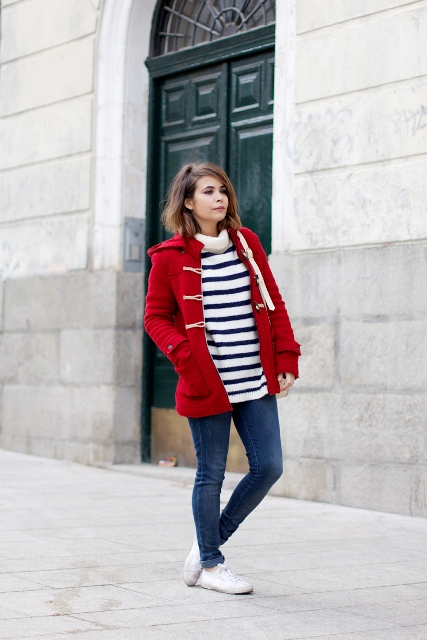 Red coat with striped sweater and jeans