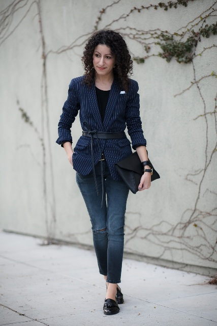 Striped navy blue jacket with distressed jeans and loafers