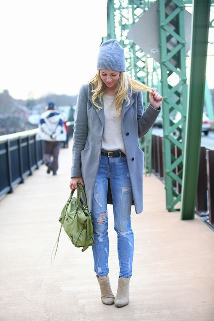 With beanie, distressed jeans and gray coat