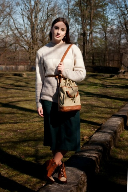With belted sweater, midi skirt and two color bag