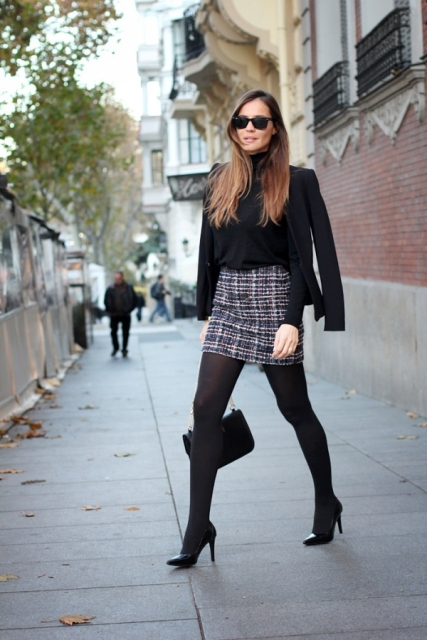 With black jacket, tights and pumps