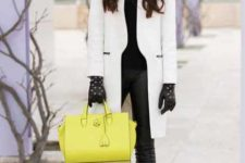 With black shirt, pants, ankle boots and yellow bag