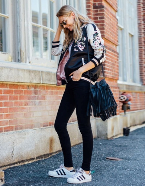 With black skinnies, fringe bag and sneakers