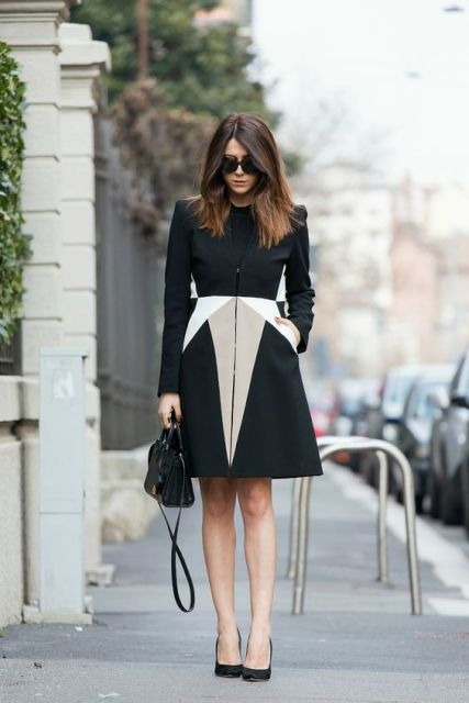 With black small bag and classic black pumps