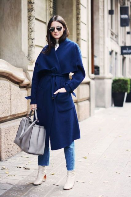 With blue midi coat and crop jeans