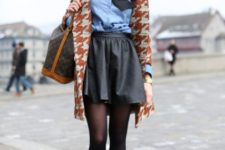With blue shirt, leather skirt and printed jacket
