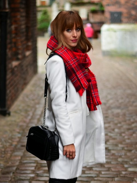 With bright plaid scarf and chain strap bag