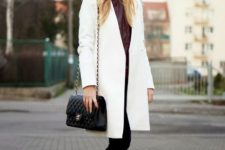 With brown boots and eye-catching beanie