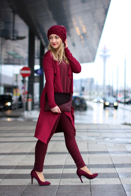 With burgundy coat, hat and heels