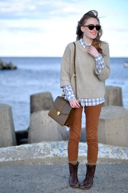 With button down shirt, oversized sweater and colored pants
