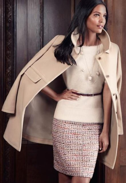 With cozy belted pullover and neutral coat