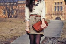 With creme sweater, leather belt and clutch