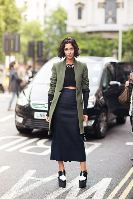 With crop top, midi skirt and platform shoes