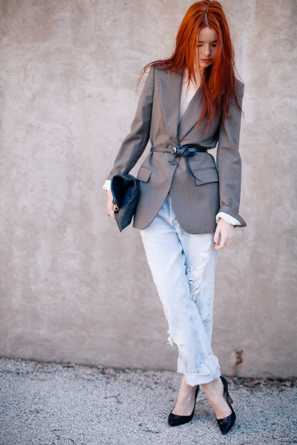 With cuffed jeans, black shoes and clutch