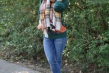 With cuffed jeans, plaid scarf and green shirt
