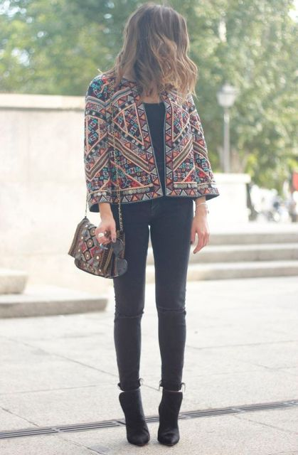 With cuffed skinny jeans, ankle boots and embroidered bag