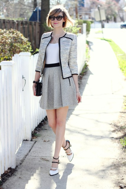 With cute tweed jacket and heels