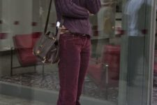 With dark color sweater and brown bag