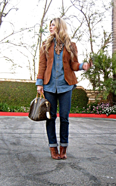 With denim shirt, suede jacket and cuffed jeans