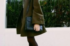 green coat with ankle boots