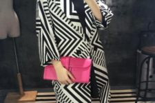 With eye-catching pink clutch