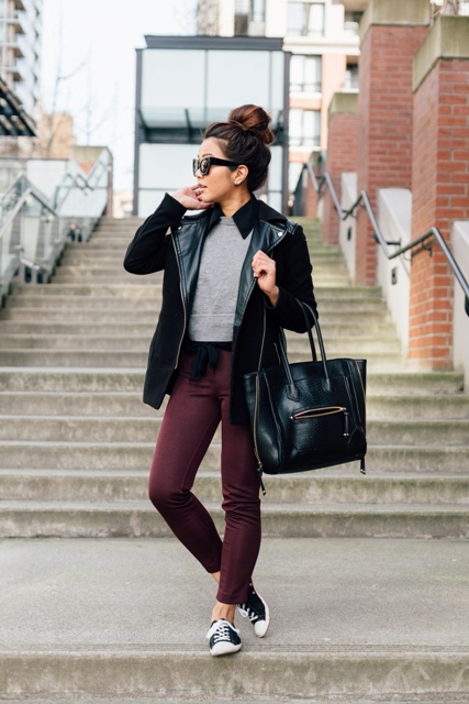 With gray crop shirt, leather jacket and bag