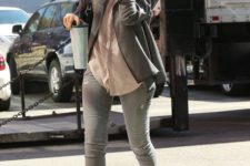 With gray jacket, pastel color shirt and skinnies