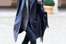 With gray jacket, skinnies and flat ankle boots