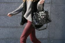 With gray sweater, fur vest and boots