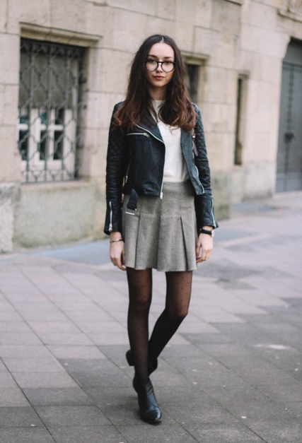 With leather jacket and ankle boots