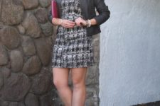 With leather jacket and bright color clutch