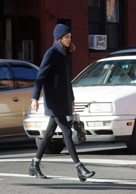 With leggings, ankle boots with socks and navy blue beanie