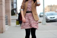 With light brown jacket, black tights and shoes