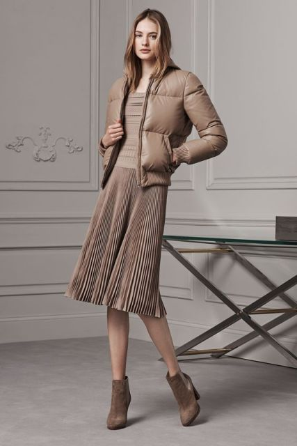 With light brown shirt, pleated skirt and ankle boots