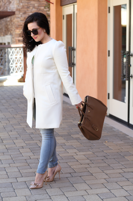White office outfit with light pink pumps and brown bag