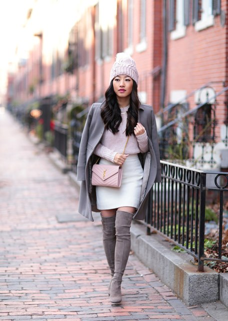 With light pink sweater, white skirt, coat and beanie