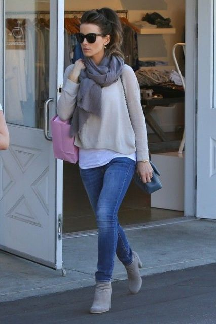 With loose sweatshirt, skinny jeans and oversized scarf
