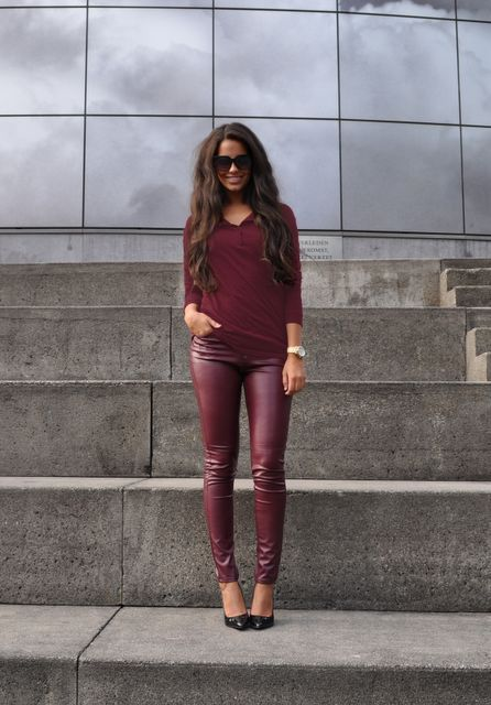 With marsala V neckline shirt and black pumps