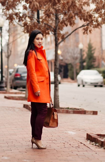 With marsala trousers, neutral pumps and brown bag
